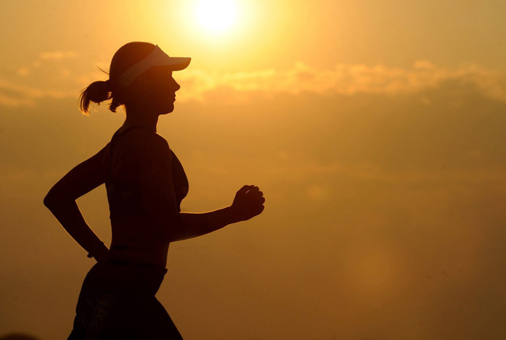 Endurance and Exercise - Female Jogging at Sunset