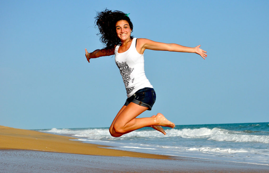 Jumping, Happy, Energetic Woman on the Beach